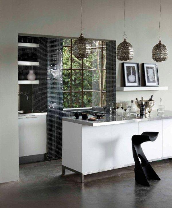 This kitchen was painted with Plascon Kitchens & Bathrooms - Evasive white Y4-E2-3. Image Source Plascon Spaces Magazine