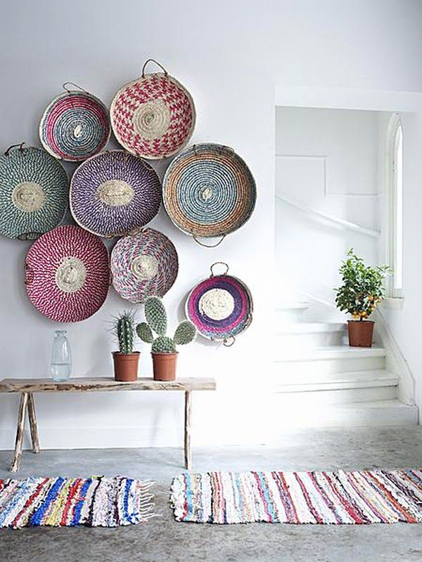 Interesting colored baskets, hung in an unexpected way - overlapping or touching, with one off to the side.  They look beautiful with the cactus plants underneath.
