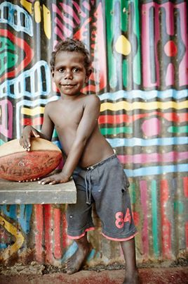 Young boy Tiwi Islands.  The Tiwi Islands are part of the Northern Territory, Australia, 80 km to the north of Darwin where the Arafura Sea joins the Timor Sea. They comprise Melville Island, Bathurst Island, and nine smaller uninhabited islands, with a combined area of 8,320 square kilometres (3,212 sq mi). Inhabited before European settlement by the Tiwi indigenous Australians, there are approximately 3,000 people on the islands. (wiki)