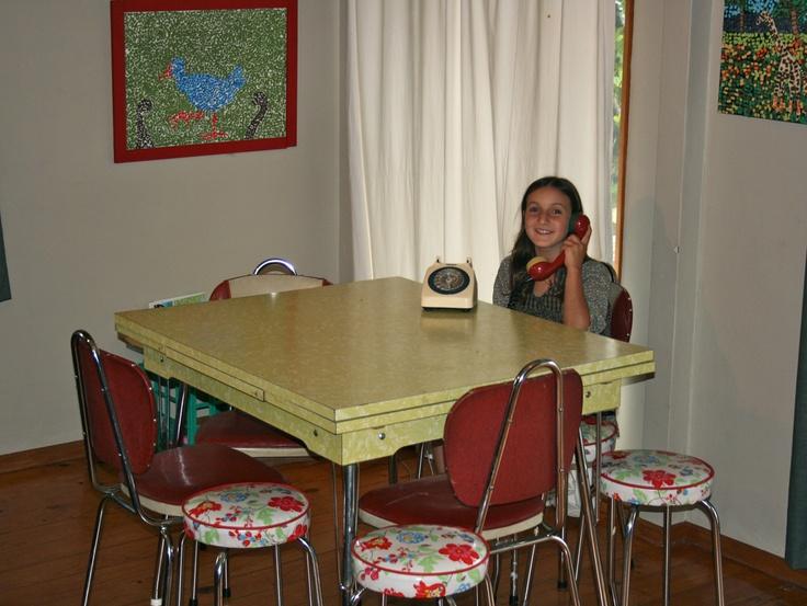 My Retro Kid, sitting on our retro chairs, talking on our retro phone beside our retro yellow formica table. Retro Rocks