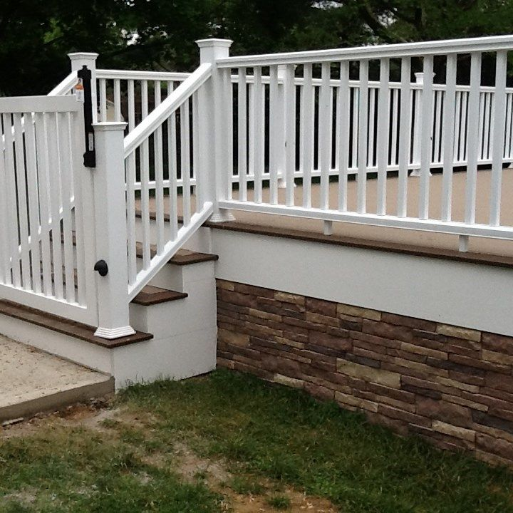 A wolf captiva deck with Deckorators CXT railing and faux stone skirting