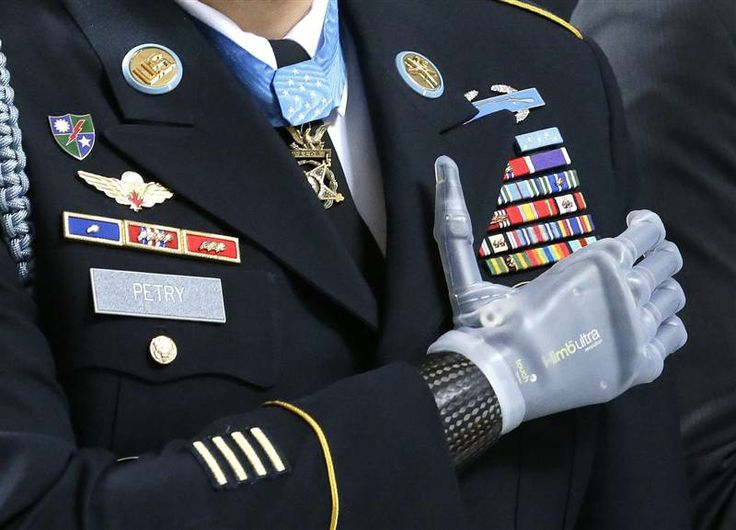 "Medal of Honor recipient Sgt. 1st Class Leroy Petry stands with his prosthetic hand over his heart during the ""Pledge of Allegiance"" at the Capitol in Olympia, Wash. on April 2. The ceremony honored Petry and other recipients of the Medal of Honor from Washington state. Petry lost his hand in 2008 when an enemy grenade he was throwing away from fellow soldiers detonated while in combat in Afghanistan"