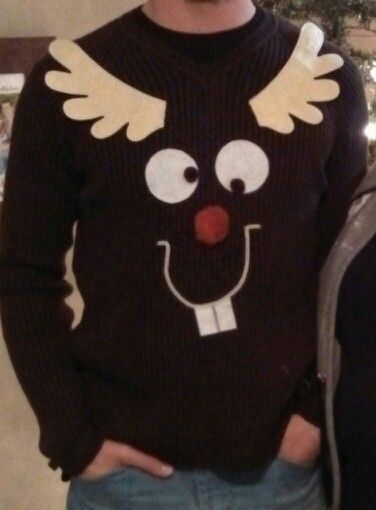 Tacky Christmas Sweater. Recycle an old brown sweater by adding felt, pipe cleaner, and pom-poms to make a reindeer face. Wear reindeer antlers as a headband or attach them to the sweater directly.
