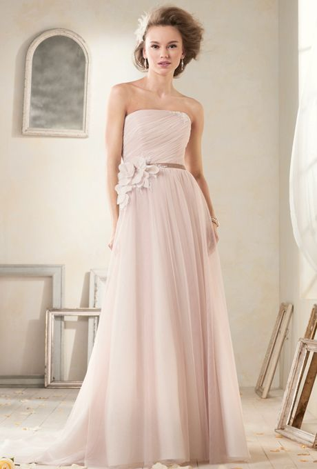 Modern Vintage by Alfred Angelo. Romantic strapless A-line gown in soft net with a delicately draped bodice. Accented at the natural waist by vintage-inspired velvet ribbon and abstract net flowers. Softly gathered skirt into a chapel length train.