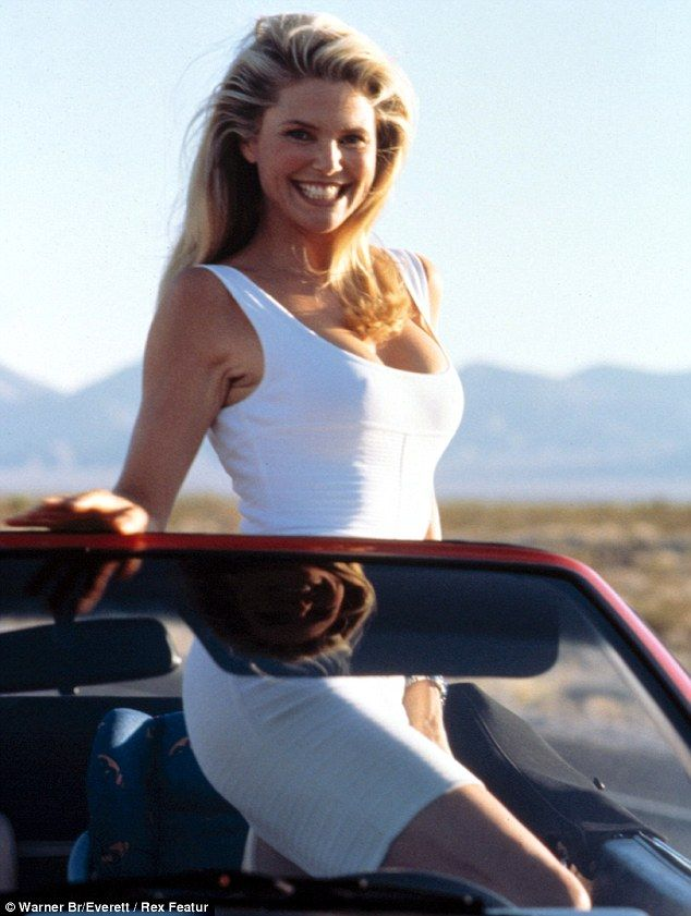 Icon: Christie poses in a white dress for a promotional shot for the comedy National Lampoon's Vegas Vacation in 1997