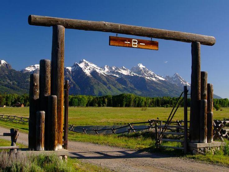 The Ranch entrance frames the Teton Range at Bar B Bar in Jackson Hole, Wyoming. www.barbbarranch.com