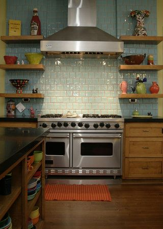 shelves up length of wall on both sides of stove. I like the colors, looks like terra cotta grout which looks so pretty with the aqua tiles.