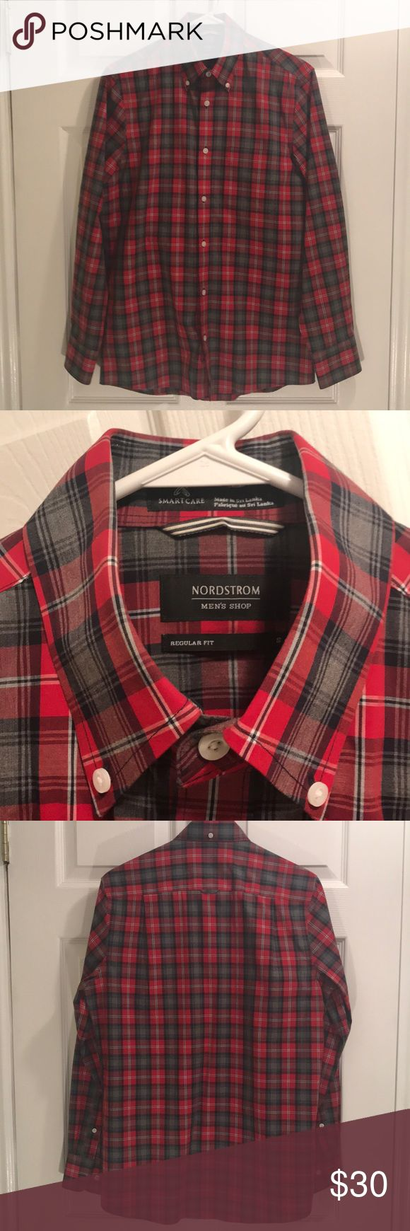"""Nordstrom Dress Shirt in Classic Plaid for Men Nordstrom Brand red, navy, and gray dress shirt for men. It's listed as a regular fit, but I'm 6'2"""" and 150 lbs (thin) and this fits me like a modern tailored shirt. I also have long arms and this is one shirt where the sleeves are actually long enough. I love the fit, but the colors don't really compliment the rest of my wardrobe. Worn once. Nordstrom Shirts Dress Shirts"""