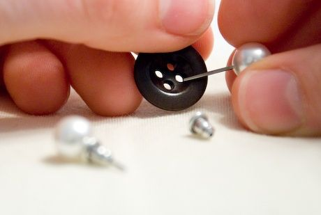 When traveling, use a button to pair earrings! genius
