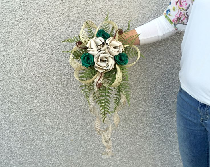 Six flower waterfall brides posy in Ivory and emerald green. www.flaxation.co.nz