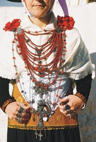 """This ibicencan woman is dressed with the tradional clothes for weddings and local celebrations. The """"emprendada"""" is the necklace with several rows, in this case coral and silver. The Balearic Islands were conquered by North African moorish on the VIII century, and reconquered by Jaime I de Aragón, catholic King in the 1234. The island is part of the Balearic Islands, on the Mediterranean sea, and not far from Algerie."""