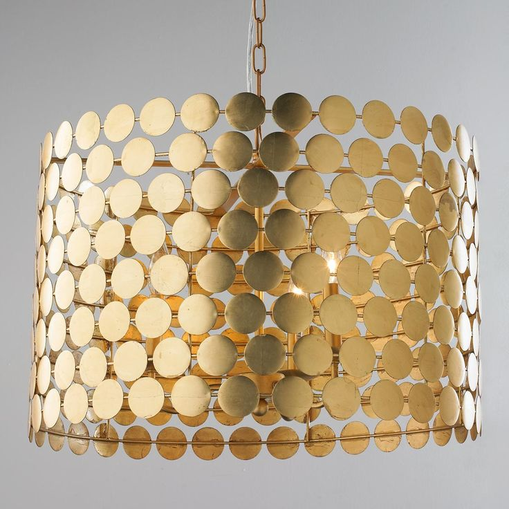 "Dotted Metal Drum Shade Chandelier Connect the dots to find this stylish mod chandelier ready to grace your home. The gold leaf finish explodes on the scene. The gold dot design is simple yet glamorous and will elevate any interior by the glowing warmth of its silhouette.  3x60 watt candle base lamps max.  (15.75""Hx24""W)"