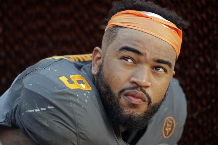 FILE - In this Sept. 24, 2016, file photo, Tennessee defensive end Derek Barnett (9) watches from the sideline during the second half of an NCAA college football game against Florida, in Knoxville, Tenn. Barnett returns to his hometown with a chance to pass Reggie White for the school's career sacks record when the 24th-ranked Volunteers visit Vanderbilt.  (AP Photo/Wade Payne, File)
