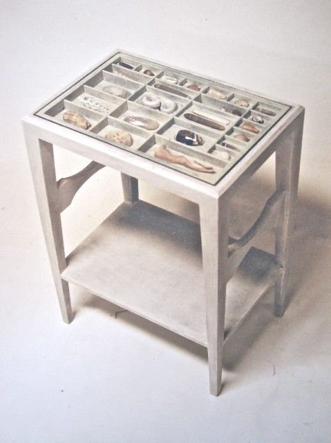 Side table with a shell display