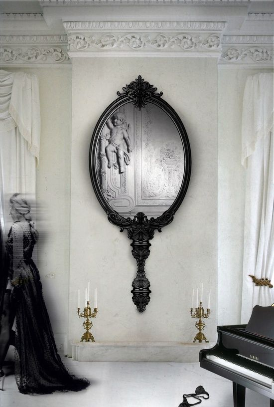 I'm not usually for decorating with mirrors, I feel it doesn't say as much about you as a piece of art. But I really like this. It has a whimsical/ fairy tale feel to it.