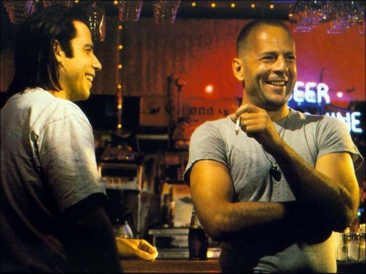 Pulp Fiction (1994). John Travolta and Bruce Willis laugh about something between scenes.