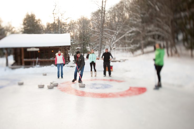 Winter Activities - The Lodge at Glendorn.  Guests enjoy a friendly curling tournament on Glendorn's Skipper Lake.