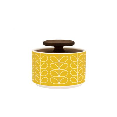 Orla Kiely: This ceramic sugar bowl with Linear Stem print will compliment any stylish kitchen, whether retro or contemporary. Lid is made of 'freijo' wood.    These ceramics are produced in Portugal and are handmade. Pieces may therefore display slightly varied characteristics.    PLEASE NOTE:  Ceramics are sold within the UK only.    Weight: 0.6kg