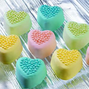 Petite Sweet Treats for Valentine's Day.  Mini cakes made in silicone heart molds.