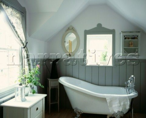 Freestanding bath with tongue and groove panelling in Hardwick White by Farrow Ball