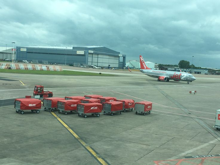 Jet2.com Airline company Boeing 737-800 Aeroplane and luggage trollies and truck