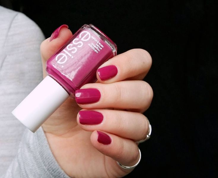 this divine essie violet infused red nail polish looks like a million bucks. sassy, flashy and rich, this 'big spender' lacquer declares: if you got it, flaunt it.