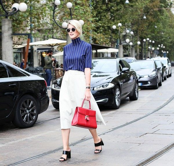 Pair a blue striped turtleneck top with a white A-line skirt, black strap heels and a red Delvaux Brillant bag:
