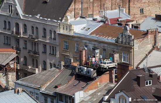 """This outdoor terrace with the """"Moskvich"""" car is one of the sights of the old Lviv city, Ukraine"""