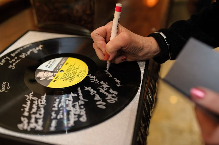 Signing a record instead of a guestbook is a unique way to remember this Sinatra soiree!