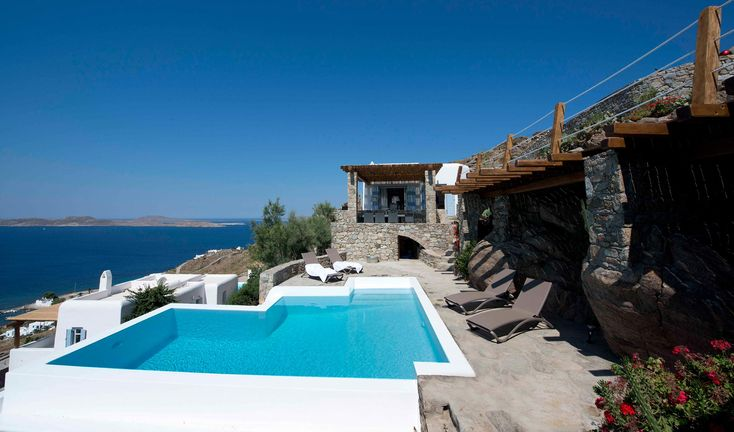Enjoying magnificent views over the bays of Ornos while the magical island of Delos lies right ahead in the open sea, this brand new villa that has never been lived-in, was built and completed only this year.
