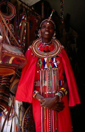 Maasai woman in front of craft shop, Nairobi, Kenya.