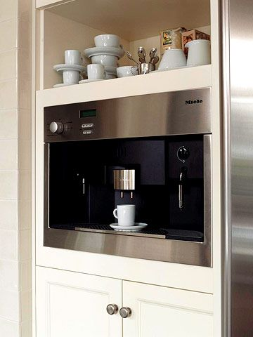 An open cabinet above the built-in espresso machine holds all the supplies for a liquid treat -- cups, saucers, spoons, and sweeteners.