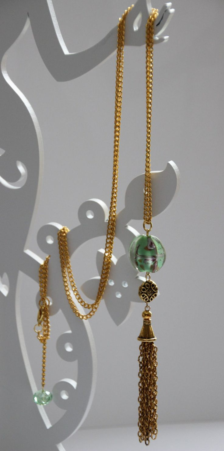 Lovely long spring green necklace with elegant gold tassel, filigree bead and lamp works feature glad bead. Free delivery in Australia. by 4Dignity on Etsy