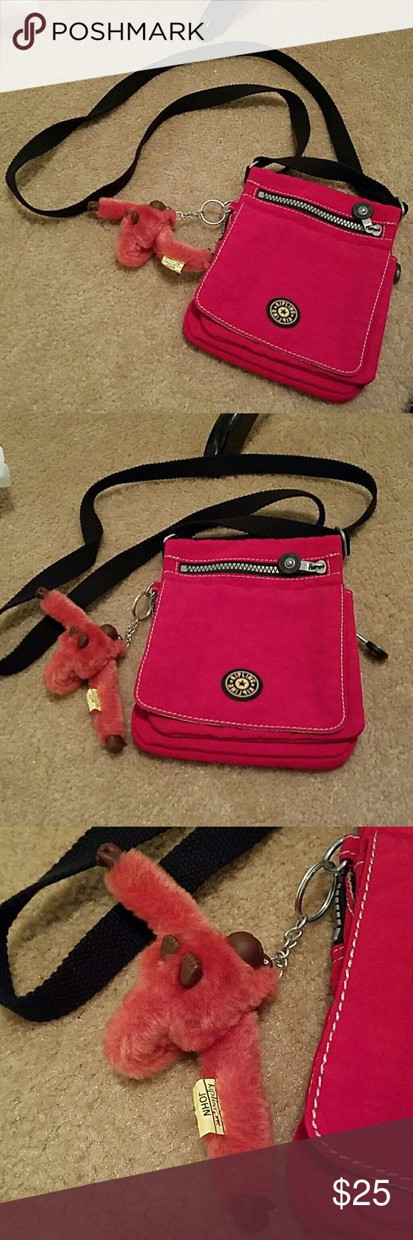 Kipling john Crossbody Handbag with Monkey Pre owned but on great condition.  Clean. Barely used. Kipling Bags Crossbody Bags