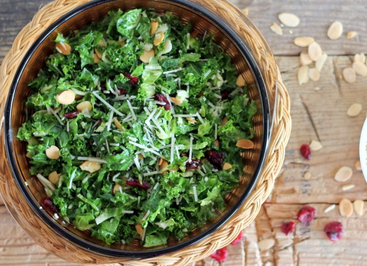 A delicious, healthy kale and brussels sprout salad with sweet cranberries, toasted almond and parmesan cheese!