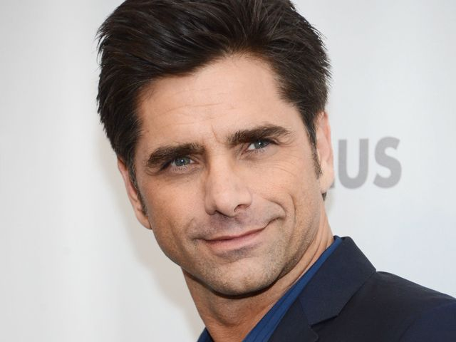 Happy 50th birthday, John Stamos! (Photo: Jason Kempin / Getty Images file)