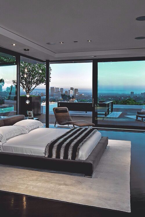 Great view if I had this bedroom I would install a pool and spa on my balcony so I could go in the spa and enjoy the view!