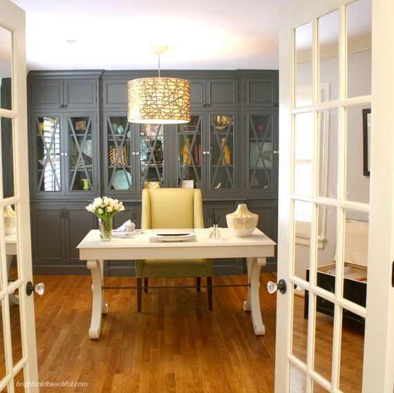 I love the mirrored panes in these French doors. They reflect the light and also create more privacy when shut.