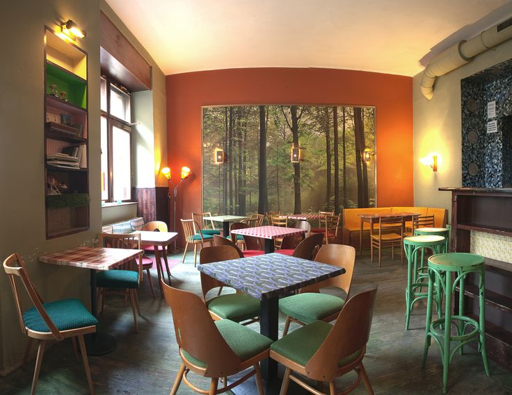 Prague Off the Map | café V lese - Vršovice Bohemian Village V lese is a likeable, eclectic affair, with rickety tables and thriftshop chairs done out in retro pastels. There's a big poster on the wall of some trees, a reference to the cafe's tongue-in-cheek name, which translates as 'Cafe in the Woods'. You can choose from a full menu of coffee drinks and cocktails as well as some light food. A popular music club downstairs brings in some of the best Czech and international rock and indie…