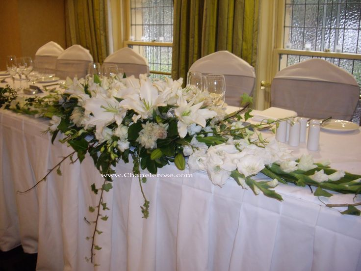 Elegant Bride And Groom Table Ideas | Beneath The Bride And Groom Of White Oriental  Lilies Roses Photo Gallery