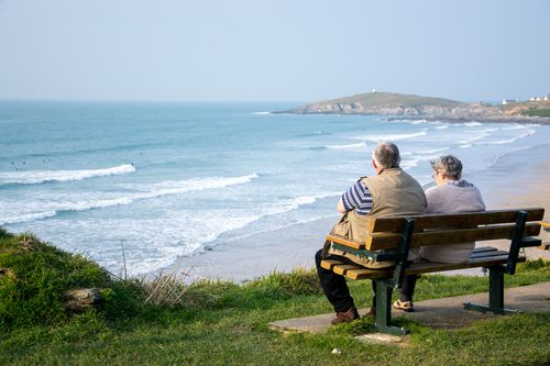 Maiden in Cornwall - Fistral Lovin' - Elderly couple watch the waves at Fistral Beach
