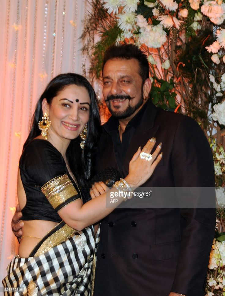 Indian Bollywood actor Sanjay Dutt(R)poses with his wife Manyata as they attend a reception after the wedding of fellow thespians Bipasha Basu and Karan Singh Grover in Mumbai late April 30, 2016. /