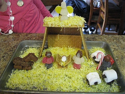 """Gingerbread"" stable and manger, marshmallow Jesus, and gumdrop Mary and Joseph. I can hardly handle the sweetness!"