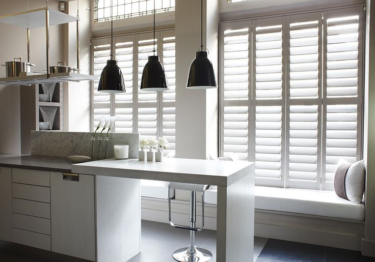 Bisque coloured Kelly Hoppen shutters in a modern kitchen