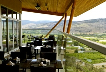 """Taraneh Ghajar Jerven of @bcliving magazine names the top 6 on-site vineyard restaurants in the Okanagan Valley.    """"First prize goes to Miradoro, the sublime partnership between Tinhorn Creek and Manuel Ferreira of Vancouver's Le Gavroche. The restaurant is a modern 4,000-sq.-ft. cork and wood space that blends effortlessly into the landscape. With two glass walls and a wraparound deck, all 130 diners have access to the breathtaking valley panorama."""""""