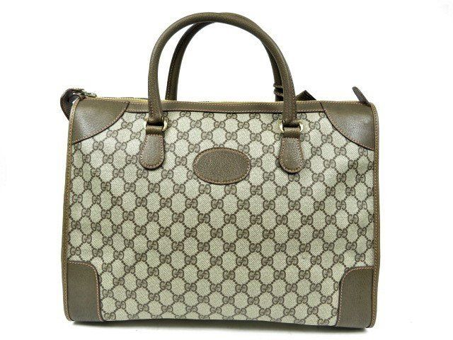 fb1faa28fb2 Vintage Gucci brown GG monogram Supreme duffle bag carry on boston bag  weekender satchel handbag