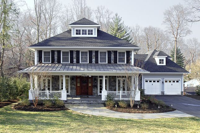 Arts And Crafts Custom Home With Stone Front Standing Seam Metal Roof And Ample Front Porch