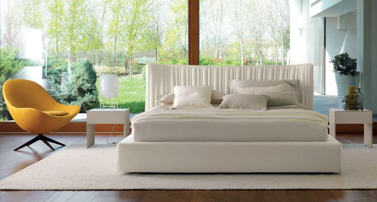 SHELLON IN - The soft and curvy headboard with its irregular, ruffled and fully-removable quilted upholstery comes with a floor-standing bed frame that is also available with a handy storage compartment.