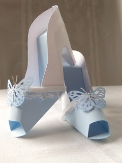 Paper crafted shoes to match a wedding card.