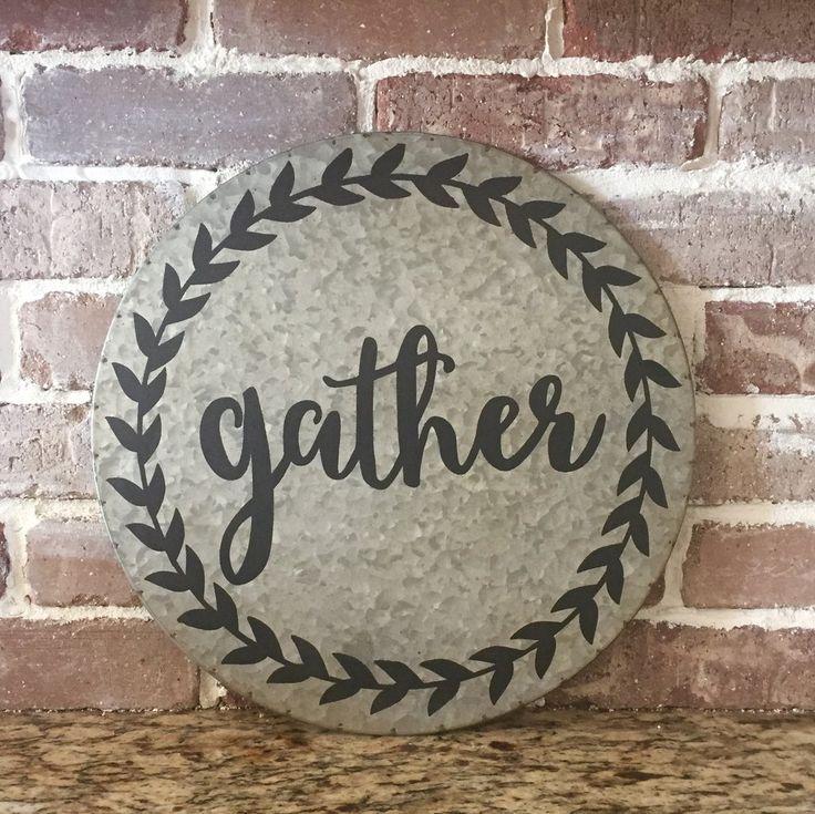 "A fun farmhouse style sign on galvanized metal! 14"" Round Tin Wall Decor Sign reads ""Gather"""